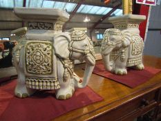 A pair of ceramic elephant form jardiniere stands