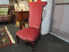 A Circa 1840 walnut open armchair with carved decoration on scroll foot cabriole legs and brass