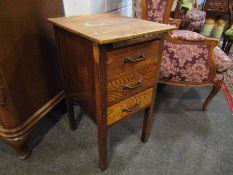 An oak bedside table with pull out tray and three drawers,