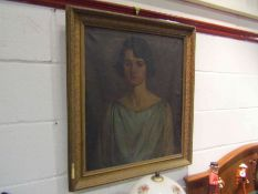 STUART ROBINSON: oil on canvas depicign a portrait of a young lady, early 20th Century, framed,