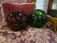 Two large glass buoys