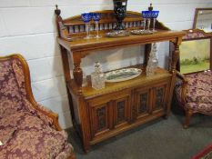 A Victorian wanlut two tier serving table/buffet with raised gallery back,