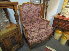 A pair of 1920's/30's French floral upholstered armchairs on cabriole legs