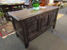 A 17th Century carved oak three panel coffer.
