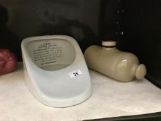 A stoneware hot water bottle and a slipper bath