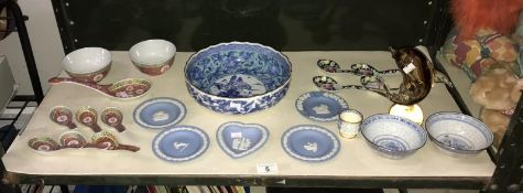 An Oriental dish, rice bowls, spoons,