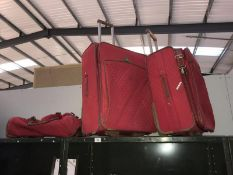 2 suitcases and matching holdall