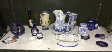 A shelf of pottery and china