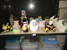 A shelf of assorted money boxes