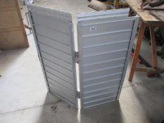 A foldable aluminium ramp.