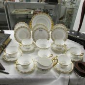 Approximately 22 pieces of Royal Crown Derby Heraldic pattern tea ware.