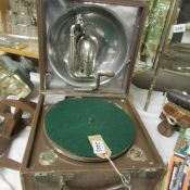 A 1920's Decca 'Trench' portable gramaphone featuring internal aluminium speaker and winding handle,
