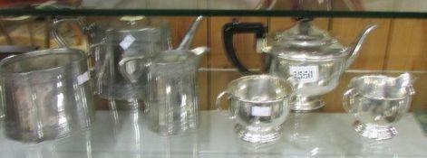 2 silver plate tea sets.