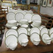 Approximately 75 pieces of Royal Doulton Clarendon pattern table ware.