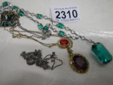 3 art deco necklaces, one stamped platinum, 2 insilver,