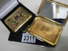 2 art deco powder compacts, one stamped Stratton, both stone set.