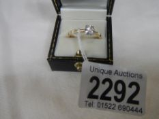 A half carat diamond solitaire yellow gold ring.