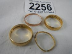 1 x 22ct gold ring (weight 4g) and 1 x 18ct gold ring (weight 4g) and 2 9ct gold rings