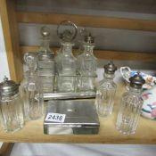 A 6 bottle cruet on stand, other cruet bottles etc.