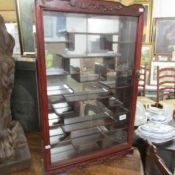 An oriental style wall mounting display cabinet, approximate height 32.