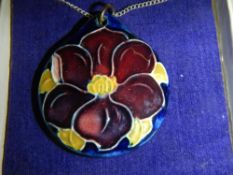An original Moorcroft pendant attached silver chain, in box.