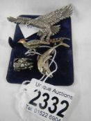 A collection of animal jewellery including a pheasant brooch with enamel head and stone set body,