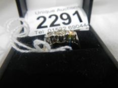 A 3 stone 18ct gold ring.