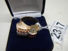 An art deco Odenesque design diamond and ruby ring in 14ct rose gold tested, total weight 12.