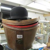 A leather cased bowler hat marked Christy's London.