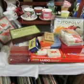 A mixed lot of vintage games and playing cards including Monopoly, Totopoly etc.