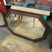 An oak framed bevel edged mirror.