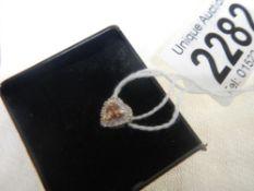 An 18ct white gold heart pendant.