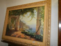 A 20th century continental coastal view in gilded frame.