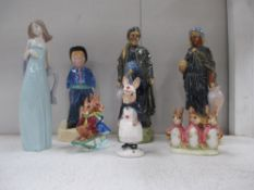 A collection of figurines including Lladro, Bunnykins,