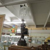 A figural table lamp.