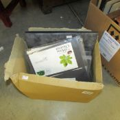 A box with an album of first day covers together with loose sleeves of covers and loose covers,