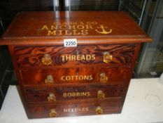 A small pitch pine chest with 4 drawers advertising cottons and bobbins and threads