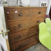 a 2 over 2 mahogany chest of drawers.
