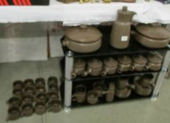 A large quantity of stoneware tea and dinner ware.