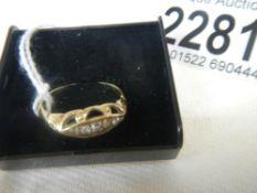 A 5 stone cushion set yellow gold ring.