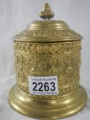 An old brass tobbaco pot with lead lining and internal lid.