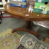 A Victorian mahogany tip top table.