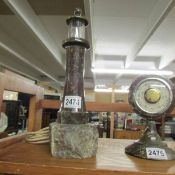 A 1930's Cornish serpentine lighthouse table lamp.