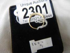 An 18ct gold 5 stone brilliant cut diamond ring.