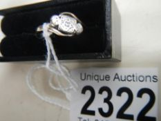 A circa 1940's diamond set twist ring stamped 18ct, platinum.