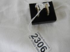 A pair of 14ct gold channel set diamond earrings.