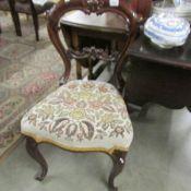 A Victorian mahogany cabriole leg chair.