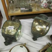 A pair of carriage lamps, probably late 19th century (one glass lens cracked).
