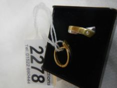 A pair of 2 tone yellow and white gold earrings.
