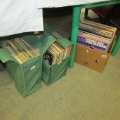 A box and 2 bags of assorted LP records.